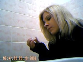 Sexy young girl spied on toilet 2