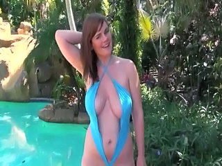 Incredibly Busty Redhead in...