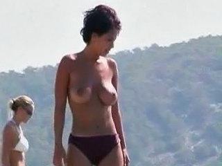 Brunette girl with nice bowels on beach
