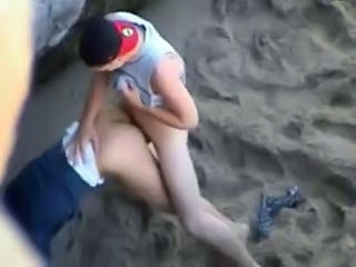 Couple fucking on the beach - by...
