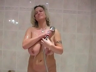 Mature with big tits in shower