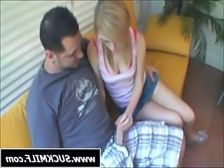 Cute little blonde teen is giving this guy a nice handjob