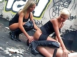Blonde bitches in black boots torturing their male slave
