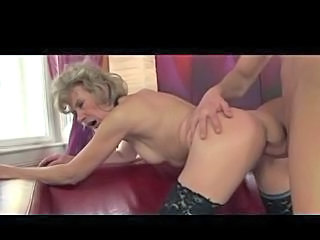 older blonde fucks younger gu...