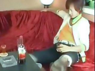 Cute Asian harlot gets it on with a customer at a club VIP room