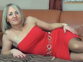 Blonde milf in sexy tight dress and pantyhose shows her undi...
