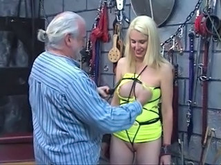Bondaged blonde would rather dispute vibrator to her cunt as older dude clamps her nipples