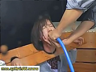 Duo naughty Asian schoolgirls are put in blocks and tortured with water