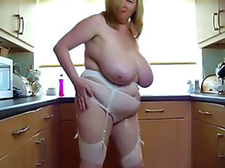 sexy bbw mature play with her big boobs all over kitchen