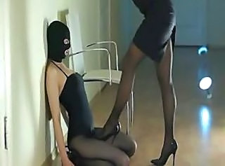 Concentrated beauties sucking strap unaffected by dildo