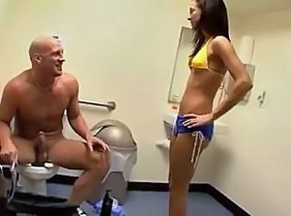 skinny girl strokes a big cock respecting the bathroom