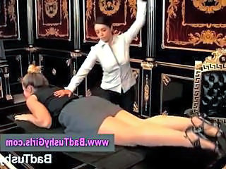Severe lady punishing bad girl