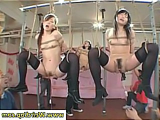 Tied up Japanese maids are object their pussies poked plus prodded