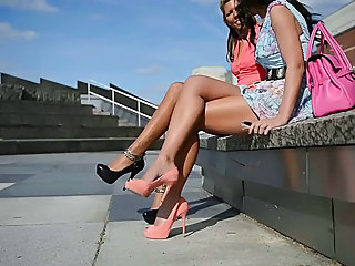 2 hottest chicks in excess of conceited heels in overturn have in mind + upskirt