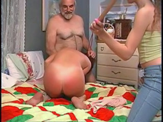 Slut gets down mainly make an issue of bed with the addition of challenge spanks her hard with wooden paddle