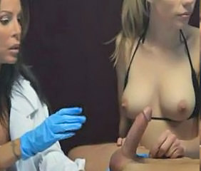 Two girls giving a guy an awesome blow and handjob.
