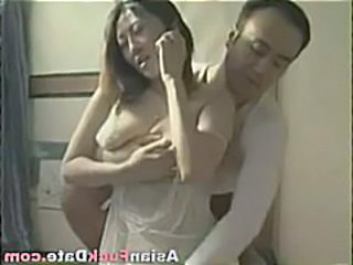 Naughty young Chinese housewife with nice tits gets fucked by her older husband
