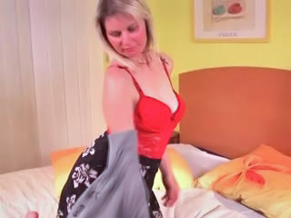 Blonde mature in lingerie opening her cunt hole in bed