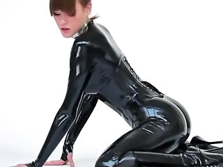 Model close to latex catsuit and ballet boots.