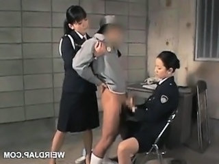 Dick starved asian police women giving handjob beside jail