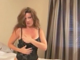 Middle aged mamasita Raquel rubs her love-button with the vibrator.