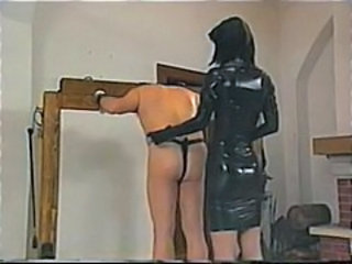 Dude is scheduled up and whipped as his latex clad mistress abuses him