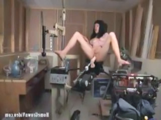 Brunette Pamela gets fucked by a copulation device and sucks cock