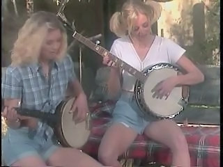 Banjo-playing blonde down-and-outs with nice tits are fucked by lucky redneck on farm