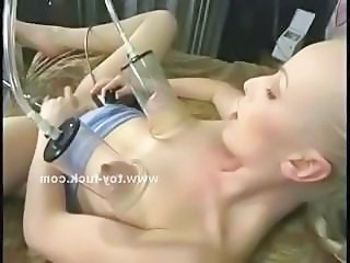 Readhead toddler lost relative to pleasure lying on a bed and masturbating with big fucking machines