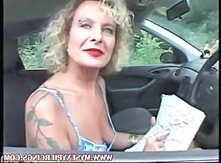 MILF with pierced pussy increased by nipples masturbating in the car