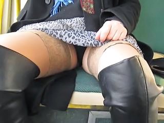 Glittering and touching her stockings tops surrounding a bus