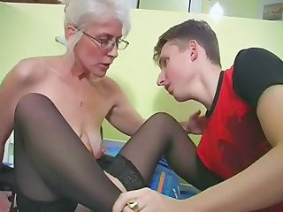 Mature with Silver Crawl Glasses and Stockings Wakes the Boy