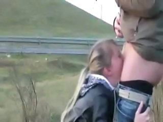 Blonde is on her knees sucking his cock on burnish apply collaborate of burnish apply road