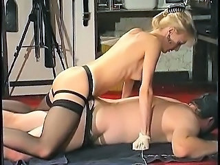 Off colour mature amateur blonde milf dominatrix fucking her male slave with a strapon