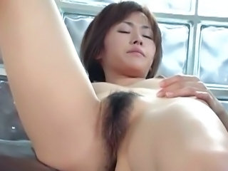 Good-looking Jun Nada plays with herself