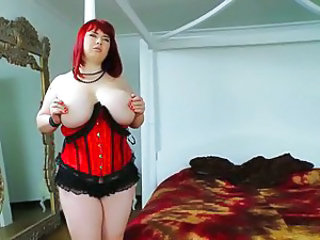 Redhead beauty with large breasts and a soft booty