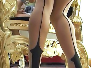 2 Hot Women with Strapon hither Stockings