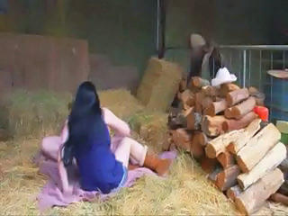 Two beamy mature lesbian cowgirls finger fucking out in the barn