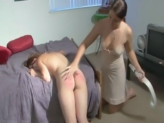 Kay spanked by her roommate Madison