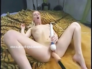 Blonde babe with small tits takes off her clothes together with starts testing fucking machines masturbating