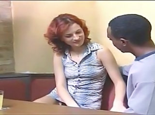 Redhead with shaved cunt sucks and gets drilled on a table