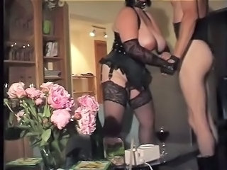 Slave with big bosom respecting black corset and Nylon Stockings