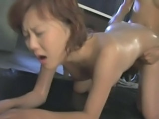 Japanese FemDom Dominates Lesbian Submissive Space fully Fucking Her With respect to Strapon...
